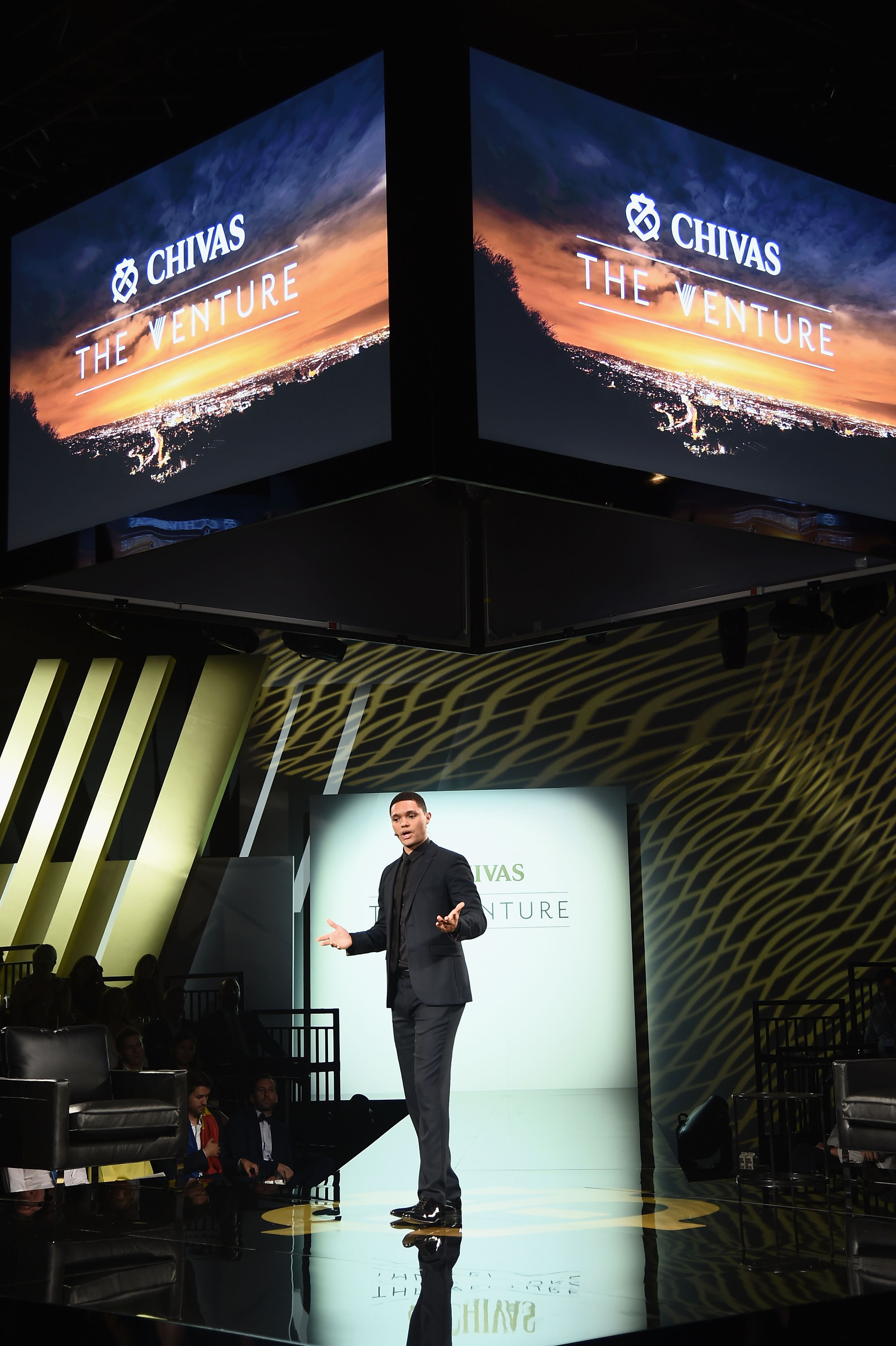 NEW YORK, NY - JULY 14:  Host Trevor Noah on stage at Chivas' The Venture Final Event on July 14, 2016 in New York City.  (Photo by Michael Loccisano/Getty Images for Chivas The Venture) *** Local Caption *** Trevor Noah